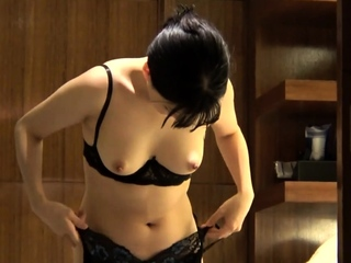 Asian masturbated with two toys